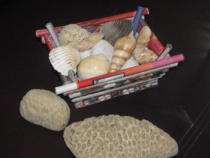 News Paper Basket filled with Sea Shells